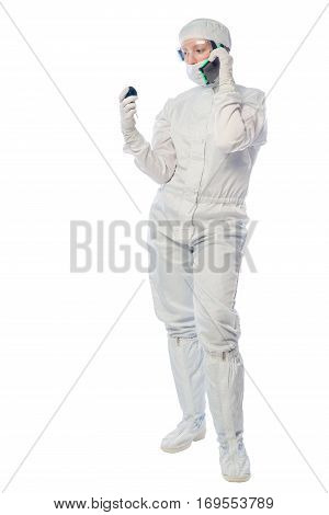 Chemist Researcher With A Telephone And An Instrument To Measure Radiation On A White Background