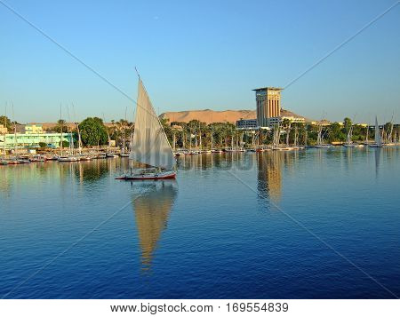 The River Nile with boats and felluca's sailing along the river taking tourists on their trip along the Nile in Egypt