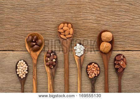 Different Kind Of Beans And Lentils In Wooden Spoon On Wood Background. Mung Bean, Groundnut, Walnut