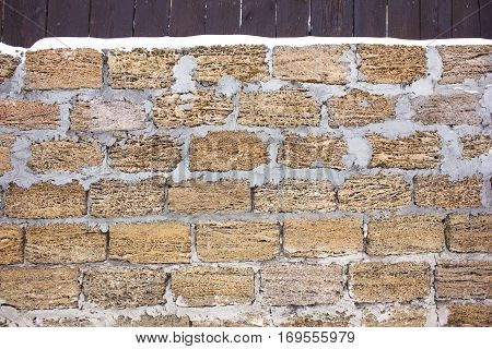 Texture Rakushnjak or coquina. Bricks Stone Sand selling of fossil corals, sponges, shells, rapanov, spongy surface. horizontal shot