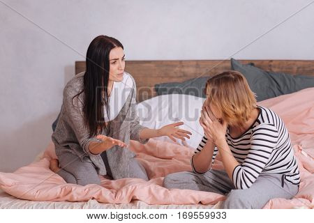 This is unfair. Emotional bitter expressive lady telling her friend about her problems and expressing her emotions while they spending time at home together