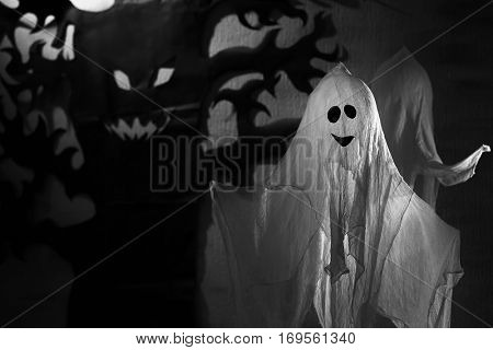 Funny ghost and creepy tree as decor for Halloween party