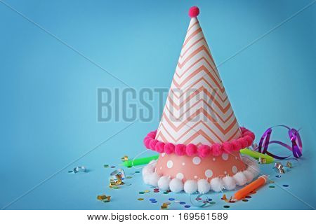 Birthday party caps on color background