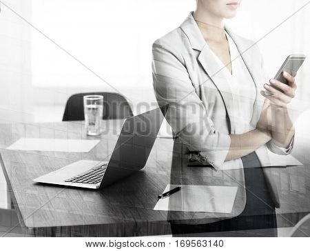 Double exposure of woman with phone and office background. Business concept.