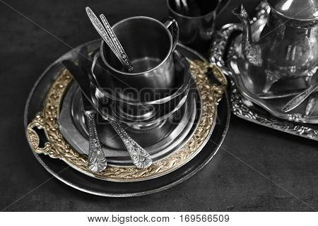 Silver dishware on table, closeup