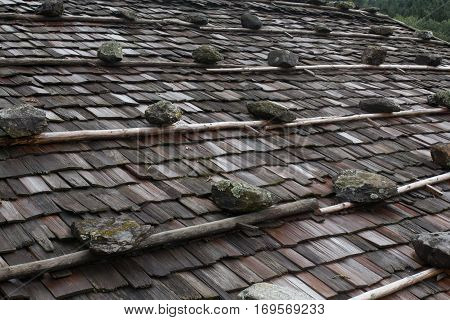 the roof of an old farm house in the alps