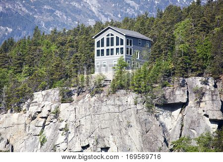The wooden house with a perfect view standing at the edge of the cliff in Skagway town.
