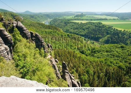 Sandstone rocks forests and blue sky in the Germany Switzerland