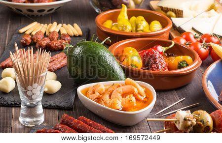 Set of Mediterranean snacks - tapas or antipasti on wooden table