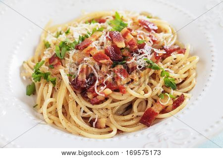 Italian pasta carbonara, spaghetti with pancetta bacon, egg and cheese sauce