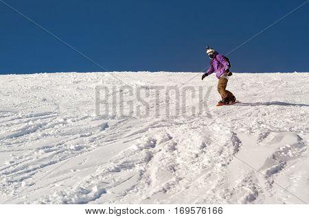 Stylysh beginner snowboarder man in caucasian mountains