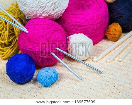 colorful knitted wool colored balls for knitting in the basket