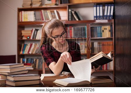 girl is preparing for the exam reads books in the Office