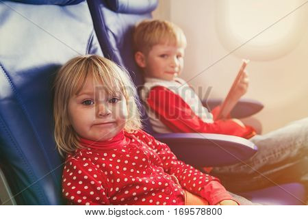 little girl and boy travel by plane, family travel