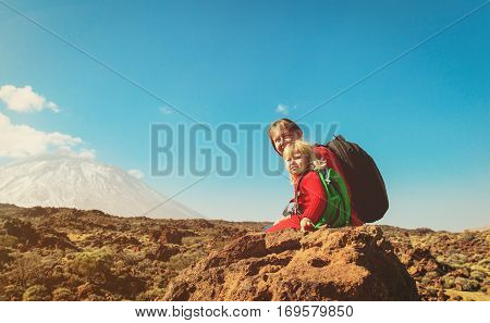 mother and little daugther hiking in mountains, family travel