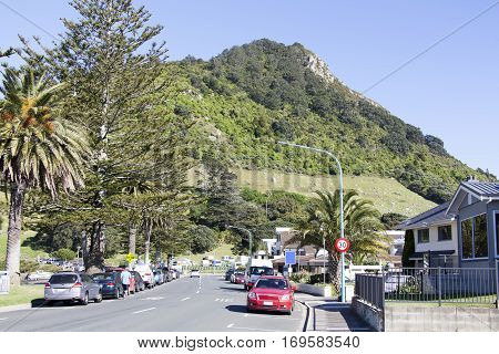 The morning view of The Mall street in Mount Maunganui resort town with Maunganui mountain in a background (Tauranga New Zealand).