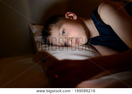 7 Years Old Child Boy Using Smartphone At Night