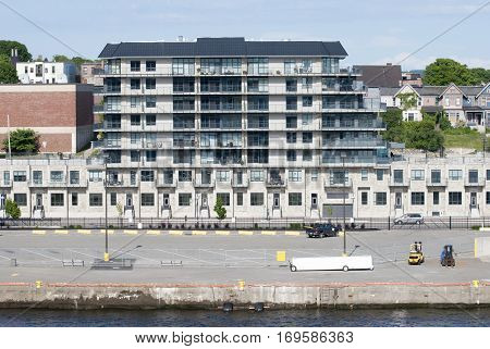 The modern apartment building standing in front of the bay in Saint John town (New Brunswick).