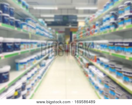 view of home painting department at hardware store blur image.