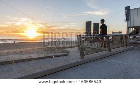 GOLD COAST, AUSTRALIA - FEBRUARY 5 2016: Watching the sunrise over the ocean at Surfers Paradise, Gold Coast