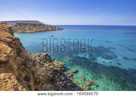 Malta - Ghajn Tuffieha bay view on a nice summer day with crystal clear sea water and blue sky