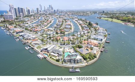 Aerial view of Macintosh Island waterfront properties, facing south with Surfers Paradise in the horizon.