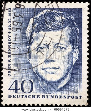 LUGA RUSSIA - FEBRUARY 7 2017: A stamp printed by GERMANY shows image portrait of John F. Kennedy 35th President of USA 1961-1963 circa 1964