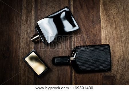 Two bootle of perfume in wooden background