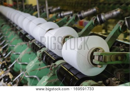 Industrial textile factory, interior. Machinery and equipment in a spinning production company
