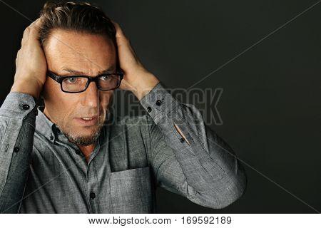 Handsome man on black background