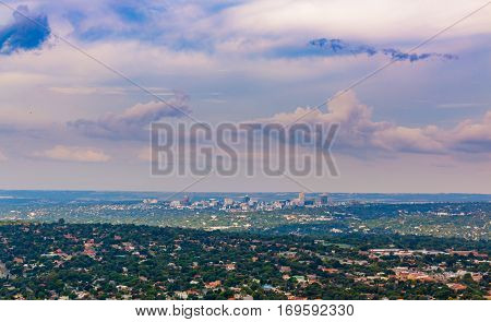 Purple pink clouds above Sandton horizon with Randburg suburbs in foreground of Johannesburg Gauteng South Africa