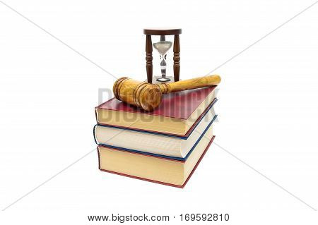 Judge gavel books and hourglass isolated on a white background. horizontal photo.