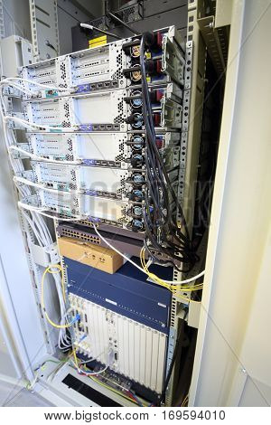 Telecom equipment with many cables and switches in communication center