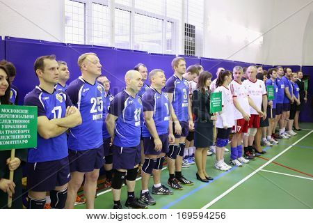 MOSCOW, RUSSIA - FEB 17, 2016: Volleyball team stands before game (Volleyball with generalship shoulder loops) in Central Customs Administration