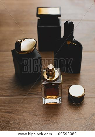 Perfumery. Different bottle of perfume in wooden background