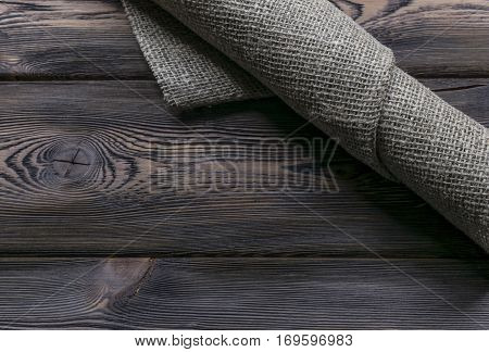Burlap texture on wooden table background texture