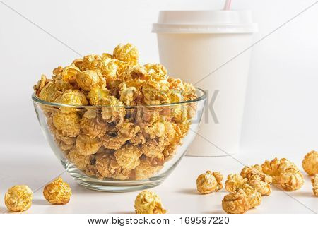 Popcorn on the table. Popcorn in glass bowl