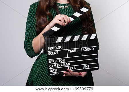 Closeup Of A Movie Clapper Keeps The Girl In The Green Dress
