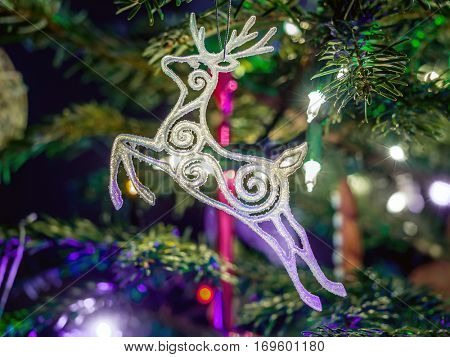 White Christmas reindeer hanging on christmas tree