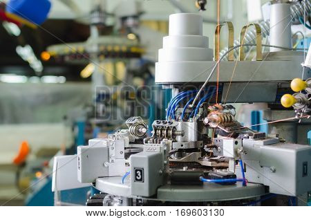 Textile: Industrial Embroidery Machine. Machinery and equipment in a spinning production company