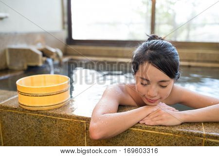 Young woman enjoy hot springs