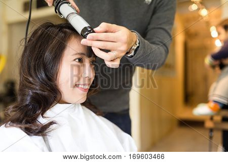 Woman making her hair in salon