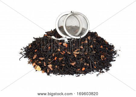 pile of organic chai tea with pumpkin and infuser ball