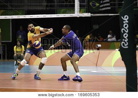 Rio Brazil. August 09 2016. Volleyball men - Mauricio BORGES ALMEIDA SILVA (BRA) and Sergio Dutra SANTOS (BRA) during Brazil (BRA) vs Canada (CAN) at the 2016 Summer Olympic Games in Maracanazinho