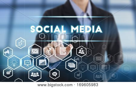 Businessman hand pressing button social media. sign on virtual screen. business futuristic technology concept.