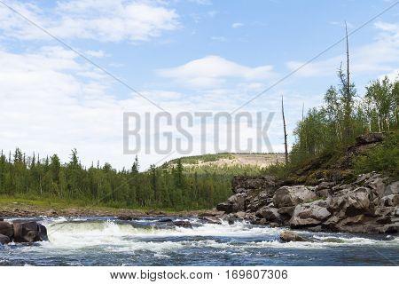 Fantastical cliffs and rapids on the river. Krasnoyarsk territory