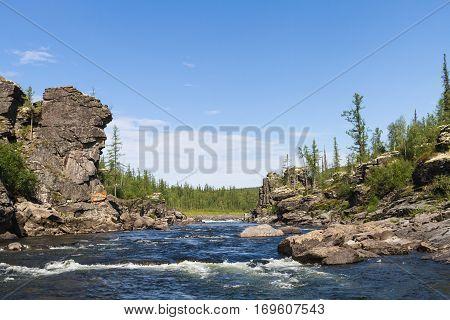 Fantastical cliffs of river rapid. Eastern Siberia. Krasnoyarsk Territory