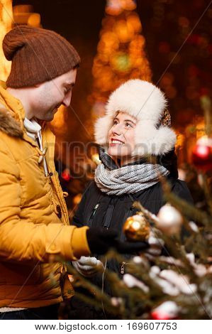 Photo of happy couple enamored on winter walk