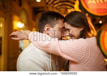 Photography of love pair in shopping mall amid garlands
