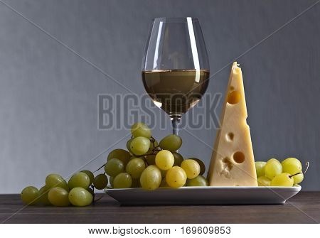 Cheese With Grape And Glass Of Wine
